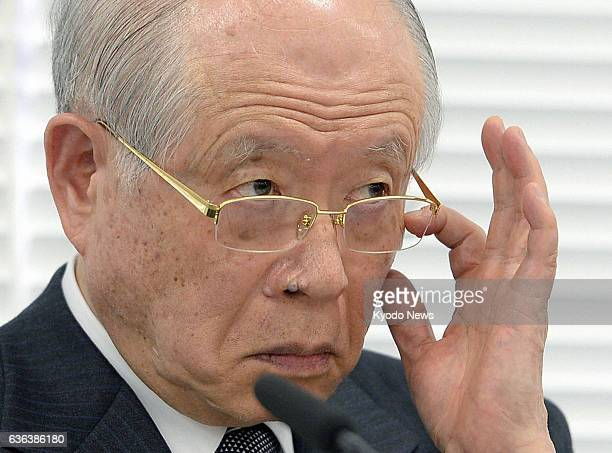 TOKYO Japan Ryoji Noyori Nobel Prize laureate and president of the governmentaffiliated Riken institute listens to a reporter's question at a press...