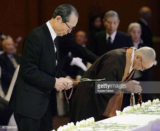 TOKYO Japan Sadaharu Oh the chairman of the board of Fukuoka SoftBank Hawks offers a floral tribute at a memorial service to mark the first...