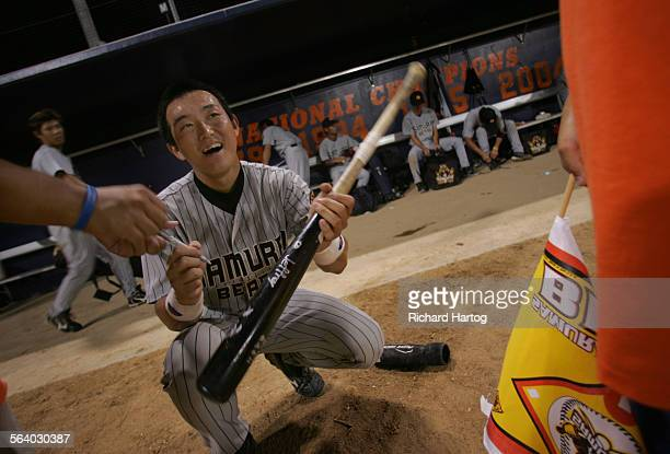 Japan Samurai Bear Shinichiro Uchino flashes a smile as he signs autographs after playing a double–header vs Fullerton Flyers Tuesday in Fullerton...