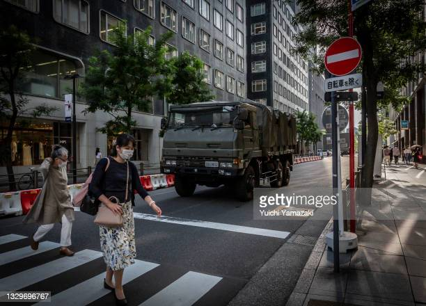 Japan self-defense force vehicle arrives at Tokyo International Forum, one of the Tokyo 2020 Olympics venues on July 20, 2021 in Tokyo, Japan. With...