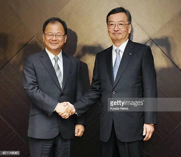 TOKYO Japan Sharp Corp President Takashi Okuda and Executive Vice President Kozo Takahashi shake hands during a press conference in Tokyo on May 14...