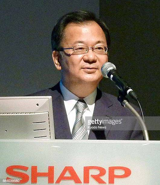 TOKYO Japan Sharp Corp President Takashi Okuda speaks during a press conference in Tokyo on June 8 2012 Sharp will cooperate with its capital...