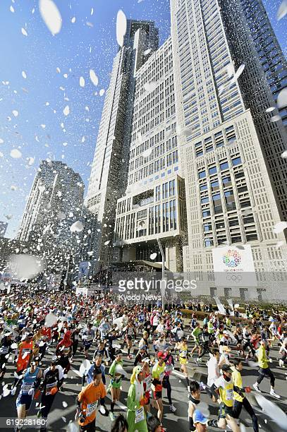 TOKYO Japan Showered with confetti runners in the Tokyo Marathon start the race from in front of the Tokyo metropolitan government offices in the...