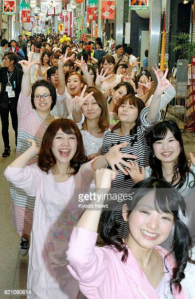 KITAKYUSHU Japan Sixty female college and vocational school students take part in a dancinginpajamasonthestreet event in Kitakyushu Fukuoka...