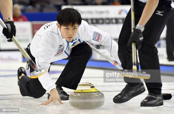 Japan skip Yusuke Morozumi makes a shot during the second end of a men's curling world championship match against Germany in Edmonton Canada on April...