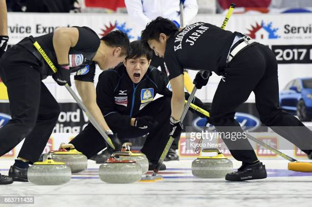 Japan skip Yusuke Morozumi yells instructions during a matchup with Italy at the men's curling world championship in Edmonton Canada on April 1 2017...