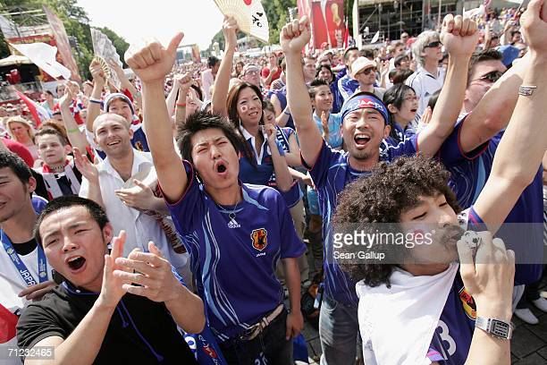 Japan soccer fans react to a play while watching the Group F World Cup 2006 match between Japan and Croatia on a large screen monitor at the Fan Fest...