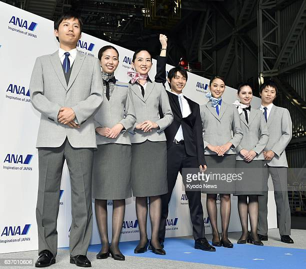 TOKYO Japan Sochi Olympics men's figure skating gold medalist Yuzuru Hanyu poses with All Nippon Airways flight attendants in new uniforms at Tokyo's...