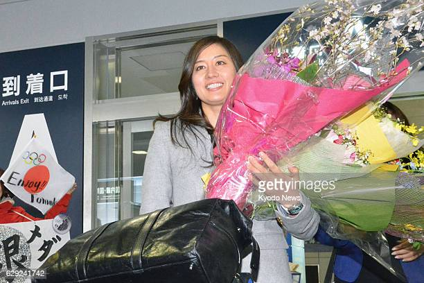 ASAHIKAWA Japan Sochi Olympics women's snowboard parallel giant slalom silver medalist Tomoka Takeuchi of Japan smiles upon arrival at her hometown's...