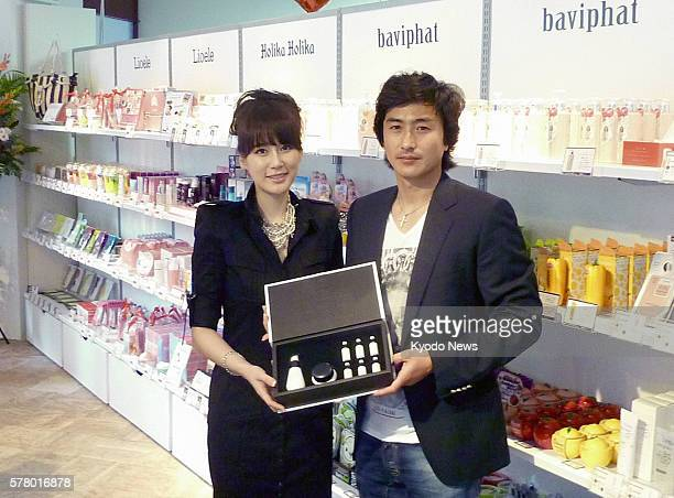 OSAKA Japan South Korean soccer player Ahn Jung Hwan and his wife visit Girls Up a store for popular South Korean cosmetics products in Osaka on June...