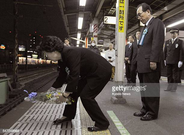 TOKYO Japan South Korean woman Shin Yoon Chan places flowers on a platform at JR ShinOkubo Station in Tokyo on Jan 26 where her son Lee Su Hyon was...