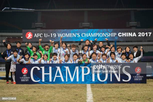 Japan squad poses for team photo with the winner trophy during their AFC U19 Women'u2019s Championship 2017 Final match between North Korea and Japan...