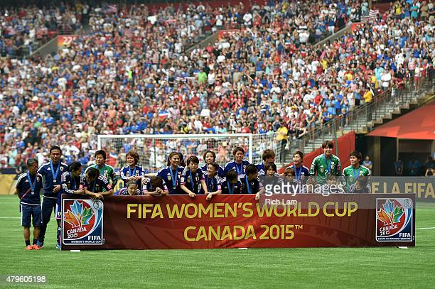 Japan stands off to the side after their 5-2 loss to the United States of America in the FIFA Women's World Cup Canada 2015 Final at BC Place Stadium...