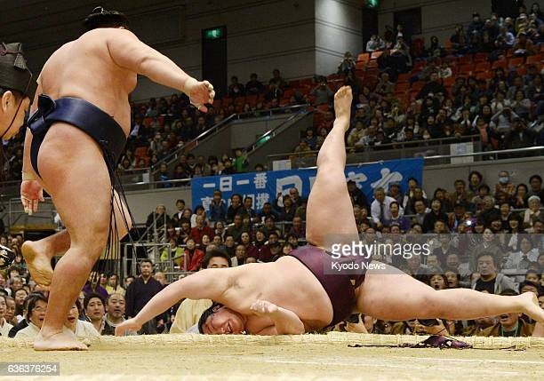 OSAKA Japan Sumo's rising star Endo is flung out of the ring by ozeki Kakuryu on the opening day of the 15day Spring Grand Sumo Tournament in Osaka...