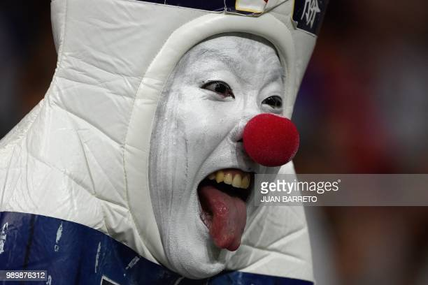 Japan supporter cheers ahead of the Russia 2018 World Cup round of 16 football match between Belgium and Japan at the Rostov Arena in RostovOnDon on...