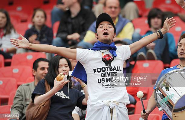 A Japan supporter cheers prior to the group B match of the FIFA women's football World Cup Japan vs Mexico on July 1 2011 in Leverkusen western...
