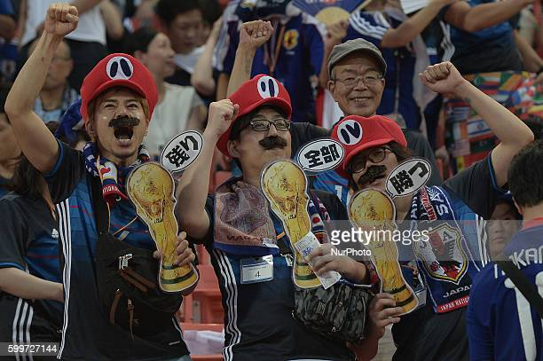 Japan supporters cheer before the 2018 World Cup Qualifiers match between Thailand and Japan at Rajamangala Stadium in Bangkok Thailand on September...