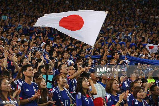Japan supporters cheer during the Kirin Challenge Cup international friendly match between Japan and Cyprus at Saitama Stadium on May 27 2014 in...