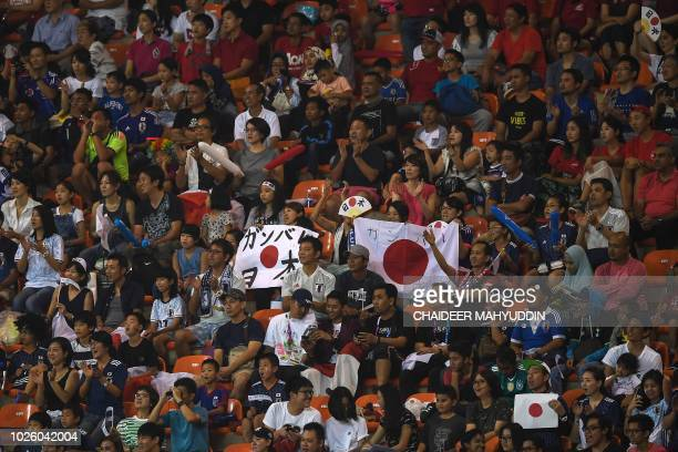 Japan supporters watch the men's football gold medal match between Japan and South Korea at the 2018 Asian Games in Pakansari Stadium at Bogor on...