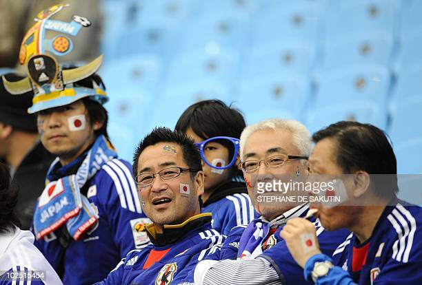 Japan supporters with Japan's national flag painted on their cheeks are pictured before the 2010 World Cup round of 16 match Paraguay versus Japan on...