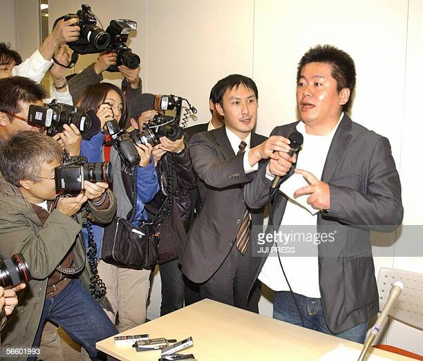 Takafumi Horie President of Japan's most successful Internet company Livedoor speaks before press after the company is raided by prosecutors on...