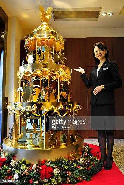 TOKYO Japan Tanaka Kikinzoku Jewelry KK displays a Christmas tree made with about 40 kilograms of pure gold at its Ginza outlet in Tokyo on Nov 21...