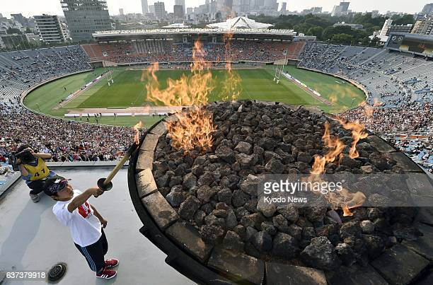 TOKYO Japan Tatsuki Kawagoe a member of the rugby team at Ishinomaki Technical High School in Miyagi Prefecture lights the Olympic cauldron at the...