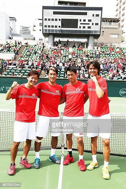 Japan team celebrate the winner during the Davis Cup World Group Playoff doubles match between at Utsubo Tennis Center on September 17 2016 in Osaka...