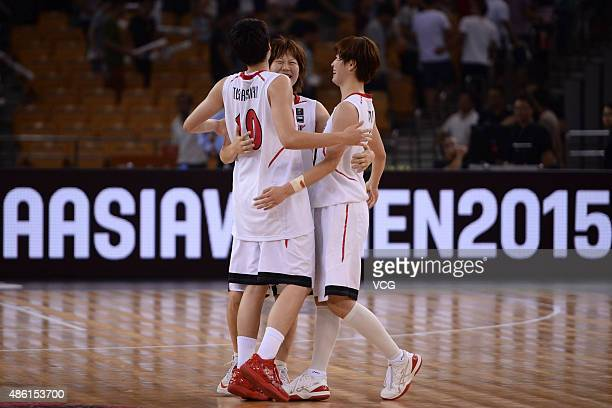 Japan team celebrates during a group match between China and Japan as part of the 2015 FIBA Asia Championship for Women at Wuhan Sports Center...