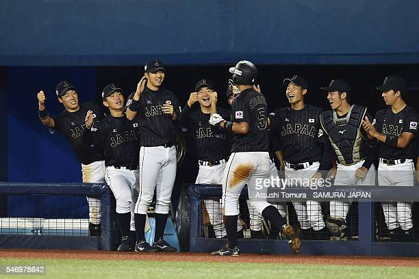 Japan team celebrates scoring a RBI single by Yota Kyoda of Japan in the top half of the fifth inning during the day 2 match between USA and Japan...
