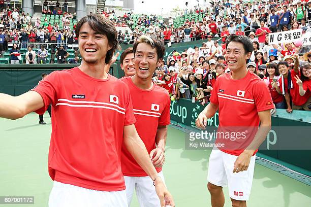 Japan team celebrates the winner during the Davis Cup World Group Playoff doubles match between at Utsubo Tennis Center on September 17 2016 in Osaka...