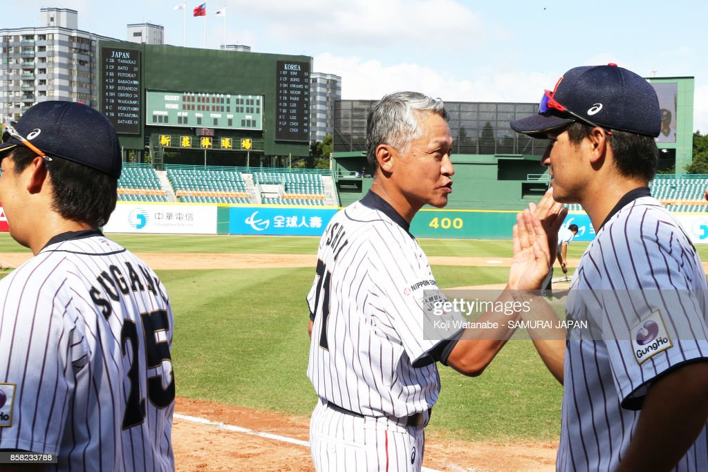 Japan team coach Akio Ishii celebrates their 3-0 victory during the 28th Asian Baseball Championship Super Round match between Japan and South Korea at Hsing-Chuang Stadium on October 6, 2017 in New Taipei City, Taiwan.
