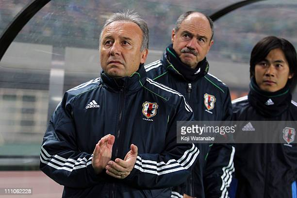 Japan team coach Alberto Zaccheroni waits for the start of the charity match for those suffer the earthquake and tsunami at Nagai Stadium on March...
