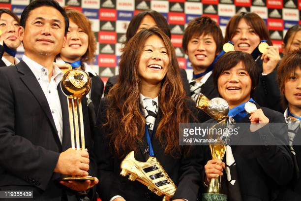 Japan team coach Norio Sasaki Homare Sawa and Shinobu Ohno attend a press conference as the Women's World Cup winning team return home at The Capitol...