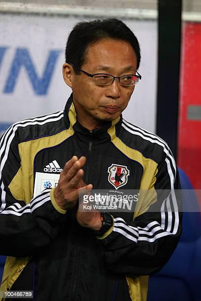 Japan team coach Takeshi Okada waits for the start of the international friendly match between Japan and South Korea at Saitama Stadium on May 24...