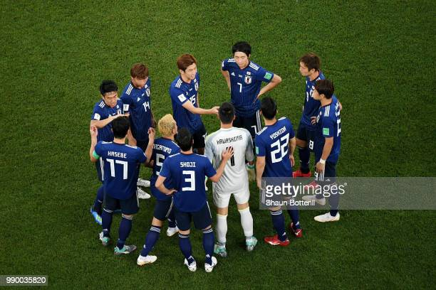 Japan team in a huddle prior to the start of the second half during the 2018 FIFA World Cup Russia Round of 16 match between Belgium and Japan at...