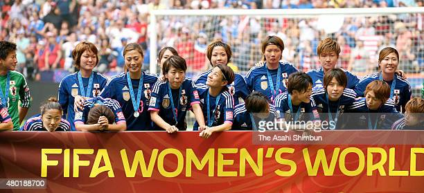 Japan team line up for photos after losing the FIFA Women's World Cup 2015 Final between USA and Japan at BC Place Stadium on July 5 2015 in...