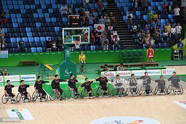 Japan team lines up for their national anthem before the Men's Wheelchair Basketball group A preliminary between Turkey and Japan during the Rio 2016...