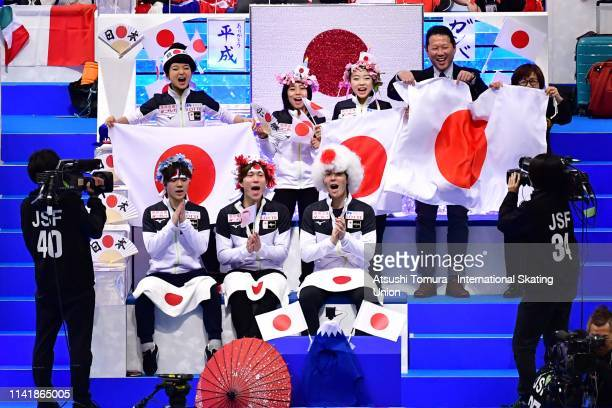Japan team members cheer for MisatoKomatsubara and TimKoleto of Japan competing in the Ice Dance Rhythm Dance on day one of the ISU Team Trophy at...