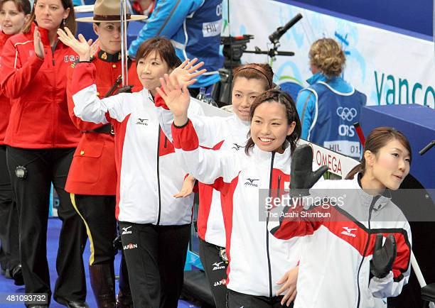 Japan team members enter prior to the Curling Women's round robin game against United States during day five of the Vancouver 2010 Winter Olympics at...