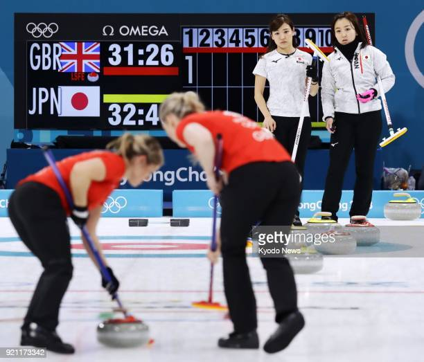 Japan team members look on during the second end of an 86 loss in a women's curling roundrobin session match against Britain at the Pyeongchang...
