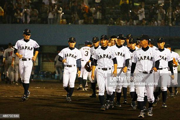 Japan team Players celebrate after winning in the first round game between Japan and USA during the 2015 WBSC U-18 Baseball World Cup at the Maishima...