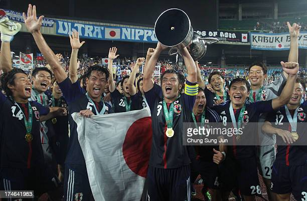 Japan team players celebrate with the trophy after winning the EAFF East Asian Cup 2013 against South Korea at Jamsil Stadium on July 28, 2013 in...