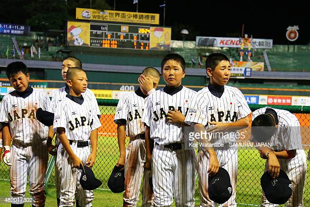 Japan team Players lose a game in the bottom half of the sixth inning in the opening round Group B game between Japan and Nicaragua during the 2015...