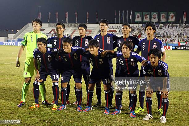 Japan team pose before the start of the AFC U19 Championship Group A match between the United Arab Emirates and Japan at Emirates Stadium on November...