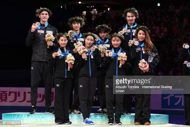 Japan team skaters pose on the podium with their golds medal during the 3rd day of the ISU World Team Trophy 2017on April 22 2017 in Tokyo Japan