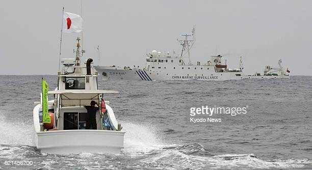 ISHIGAKI Japan The Chinese maritime surveillance vessel Haijian 46 prevents a Japanese fishing boat from sailing ahead on May 26 in Japanese...
