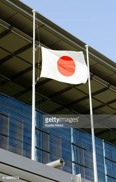 TOKYO Japan The Japanese flag flies at halfmast at the prime minister's office in Toyo on Jan 25 in a sign of mourning for the victims of a hostage...