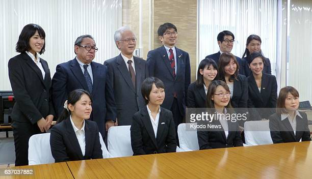 NAGASAKI Japan The Nagasaki Youth Delegation comprising eight female university students poses with Nagasaki Mayor Tomihisa Taue at Nagasaki...