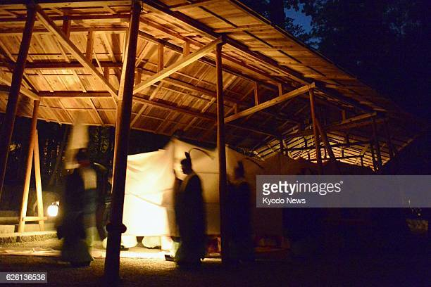 Japan - The shrine deity, protected with silk cloth, is carried by Shinto priests to a new building at the Naiku complex of Ise Grand Shrine in Ise,...